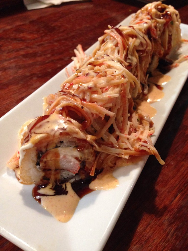 Nippers - Jax beach crawler tempura fried roll, spicy krab salad, cream cheese, shrimp sauce, sriracha, sweet soy reduction